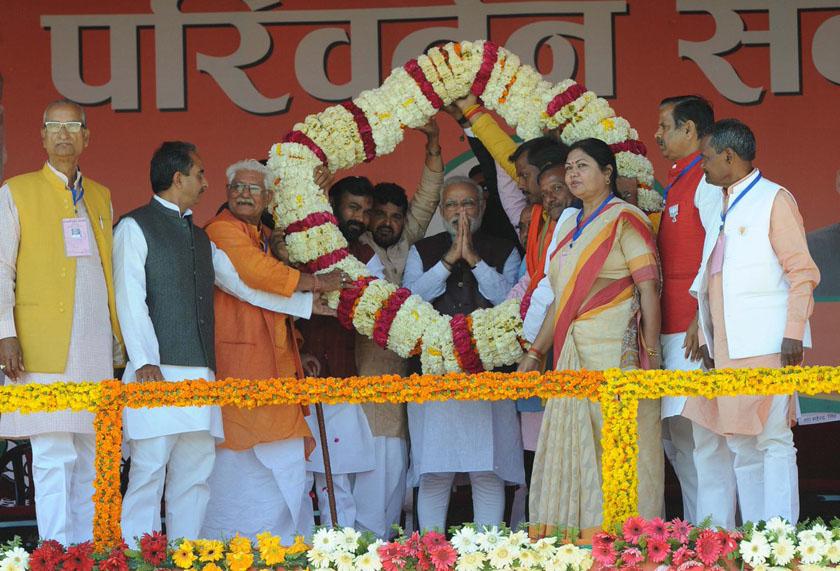 Prime Minister Narendra Modi honored with mala