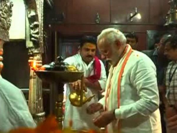 Prime Minister Narendra Modi is offering prayer