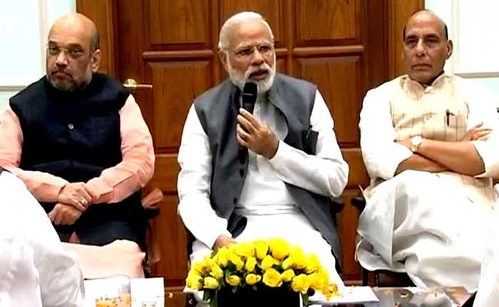 Prime Minister Narendra Modi speaking to Uttar Pradesh's MPs