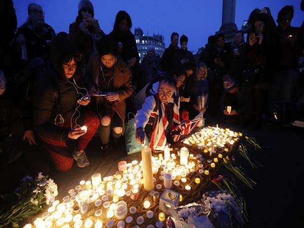 Londoners trickled into Trafalgar Square for a vigil
