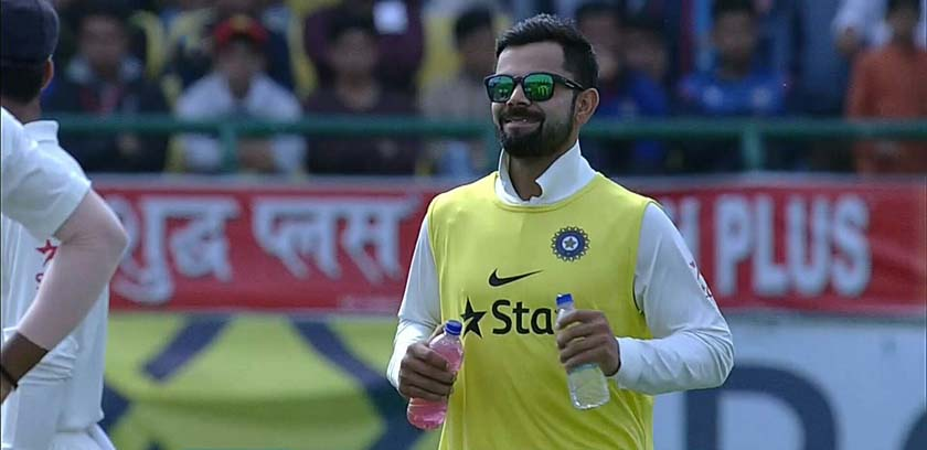 Indian player Virat Kohli bringing energy drinks for his teammates