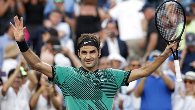 Roger Federer celebrates after his match against Roberto Bautista Agut at the Miami Open