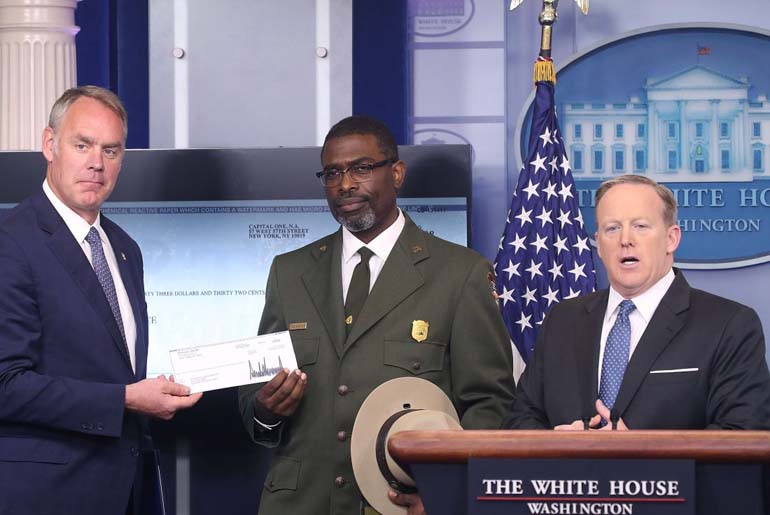White House press secretary Sean Spicer announcing to donate US President Donald Trump's  first-quarter salary that is USD 78,333 to the National Park Service