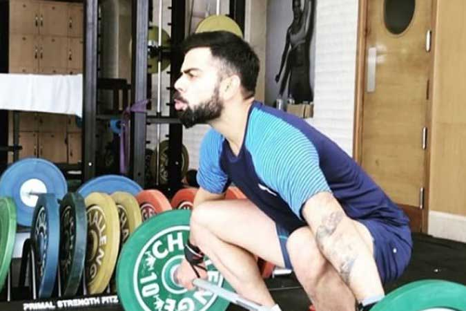 Virat Kohli doing a weightlifting clean and jerk drill