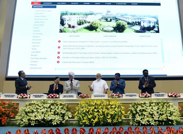 Prime Minister Narendra Modi launching a digital database for the Supreme Court