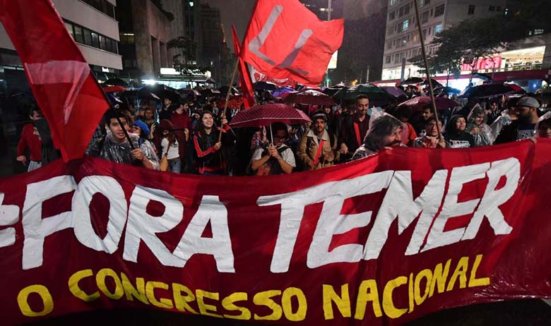 Demonstrators protest against Brazilian President Michel Temer in Sao Paulo