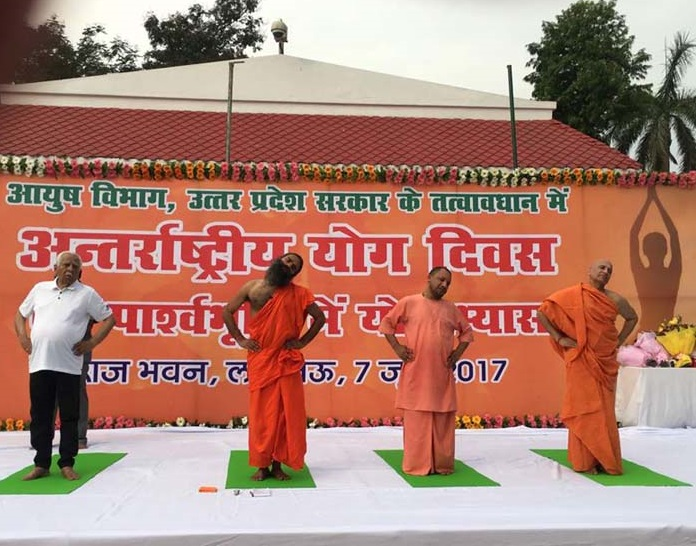 Uttar Pradesh Chief Minister Yogi Adityanath, Governor Ram Naik and Baba Ramdev performing yoga