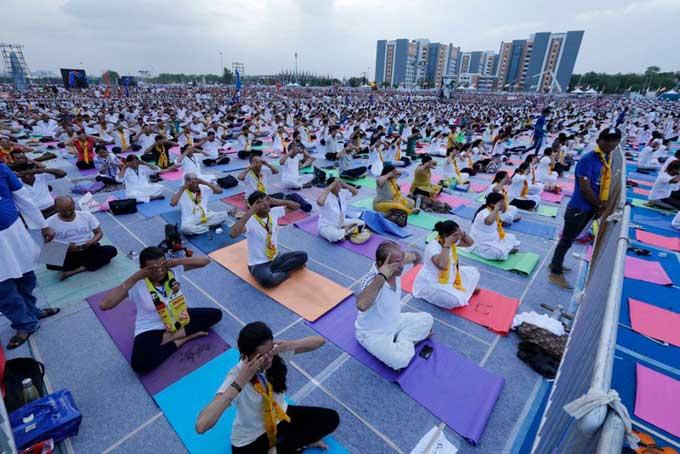People performing yoga in Gujarat