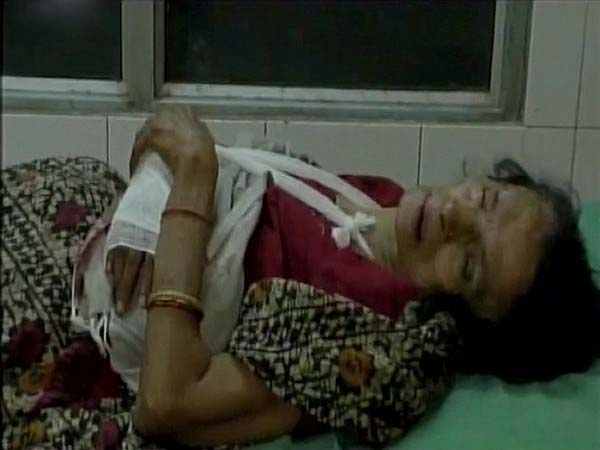 The victim, Prem Devi, was taken to the district hospital by her younger son