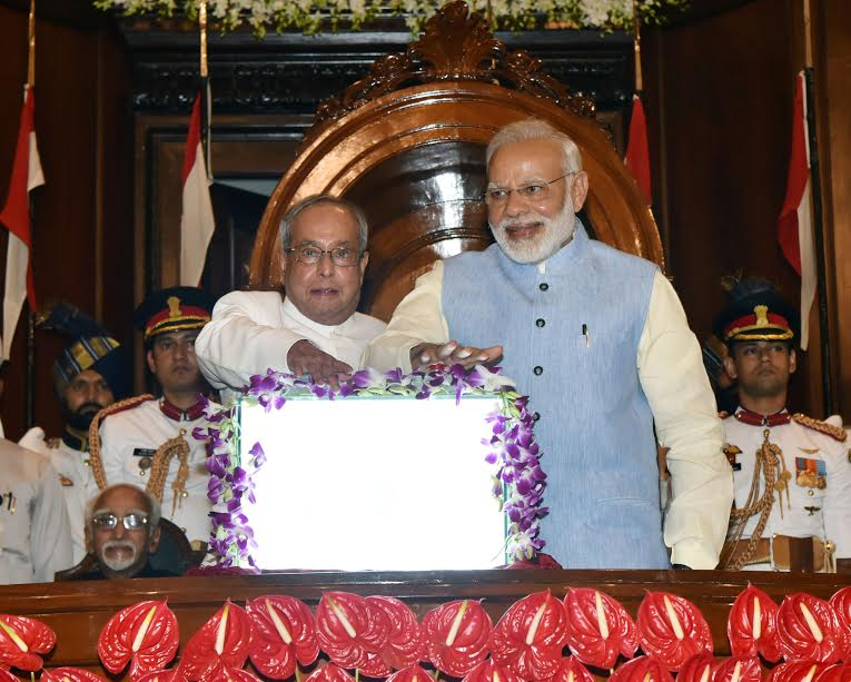 President Pranab Mukherjee, Prime Minister Narendra Modi press button to officially launch GST