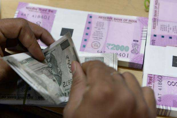 Rupee gains by 8 paise