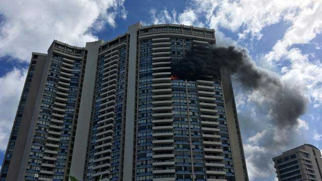 Smoke billows from a high-rise apartment building in Honolulu