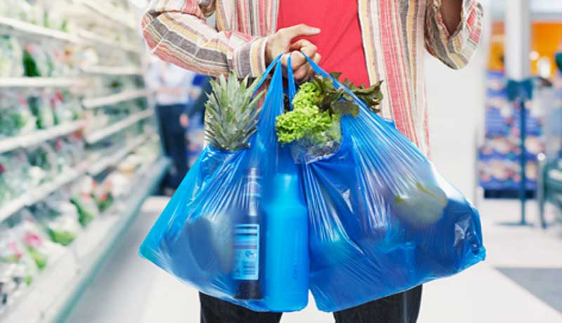 A view of man holding polythene bags (File Photo)