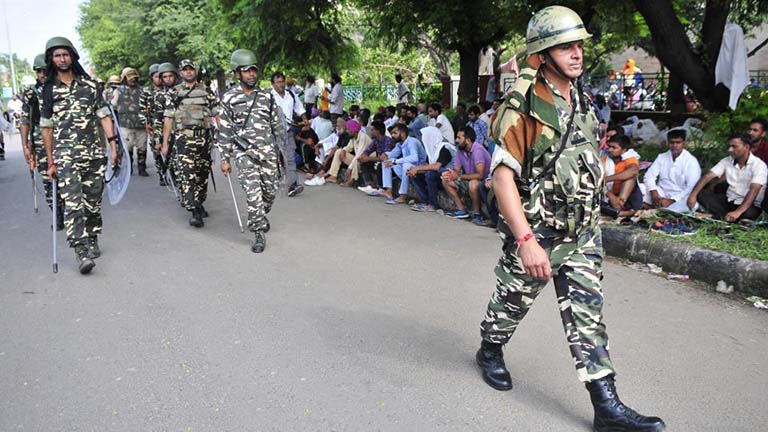 Security personnel conduct a flag march in Panchkula's Sector 5