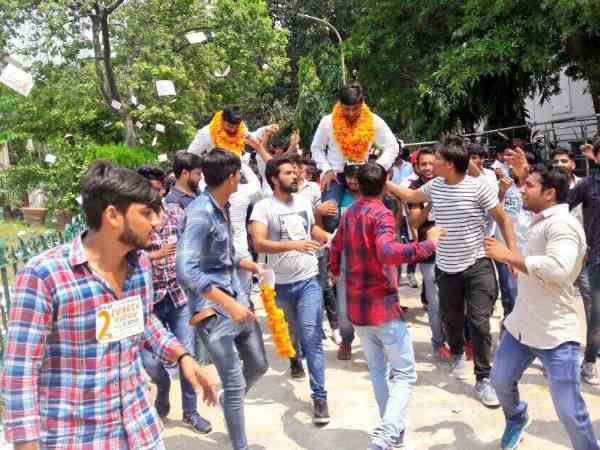 Student celebrating after winning in Delhi