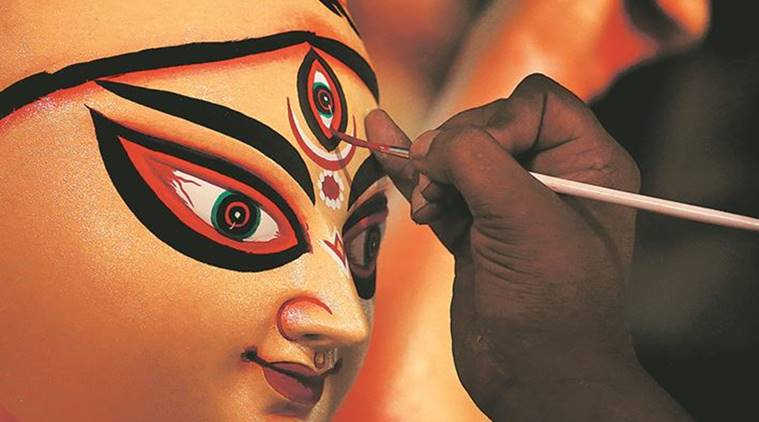 An artisan works on an idol of Durga at a workshop