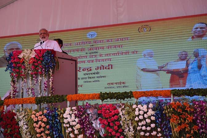 PM Modi addressing a public meeting after inaugurating a 'Pashu Arogya Mela'