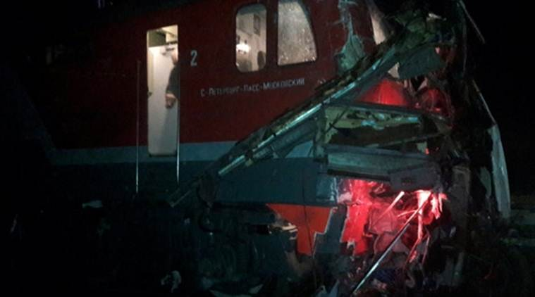 The wreckage of a train is seen after it hit a passenger bus at a crossing near the town of Pokrov
