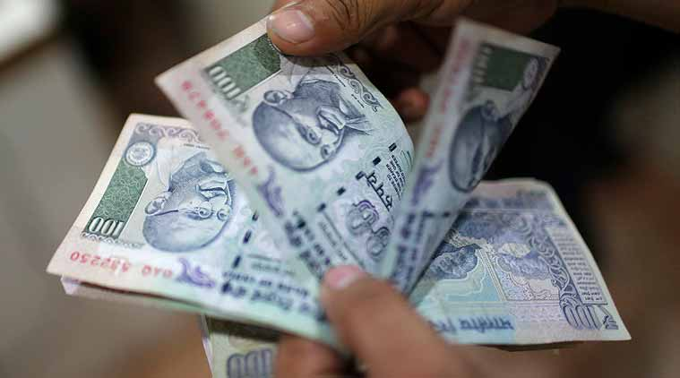 Rupee gains by 11 paise