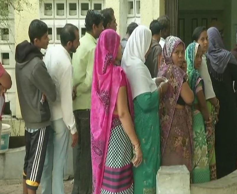 People wait in queue to cast their vote in Bharuch's Ankleshwar