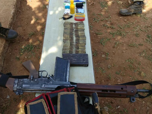 An improvised explosive device (IED), one self-loading rifle and ammunition