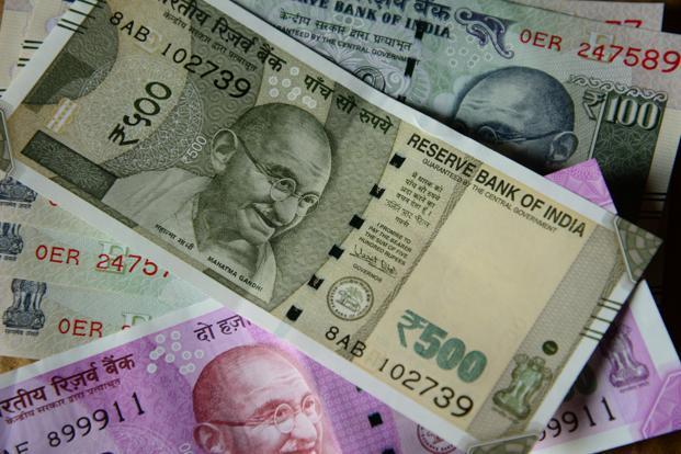 Rupee gains 14 paise
