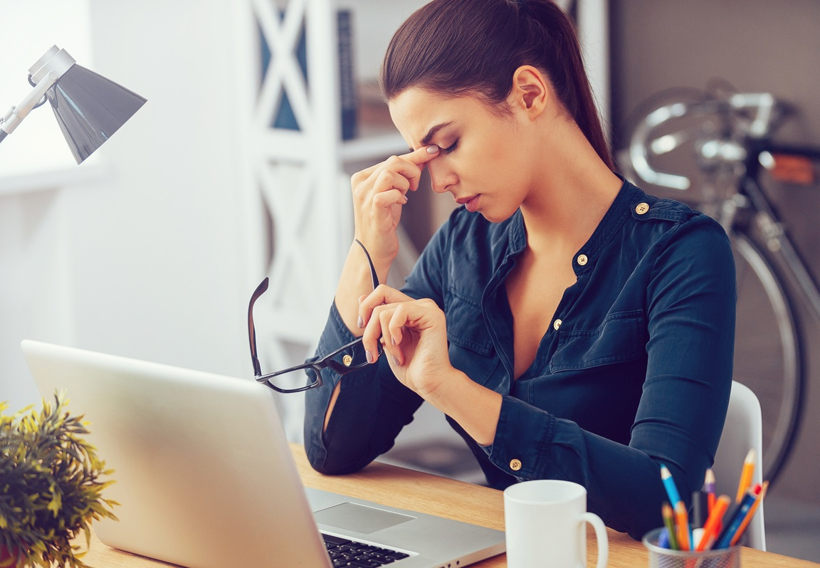 A woman sitting depressed at work