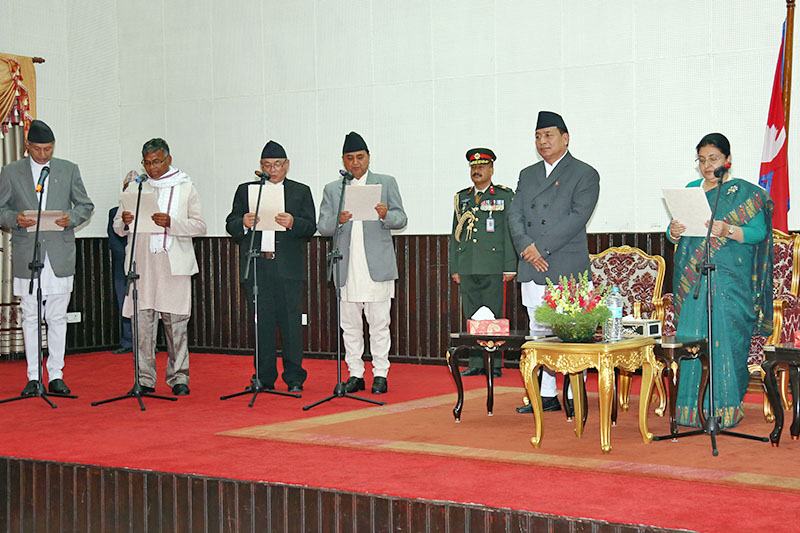 President Bidya Devi Bhandari administers the oath of office and secrecy to newly appointed ministers at Sheetal Niwas