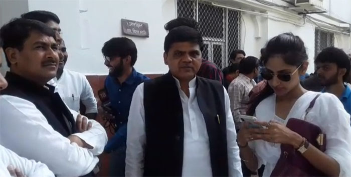 Party leaders standing outside the voting poll in Lucknow