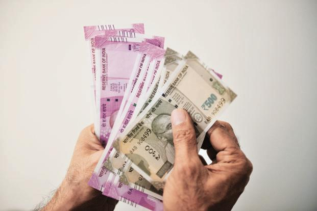 Rupee traded lower by 4 paise