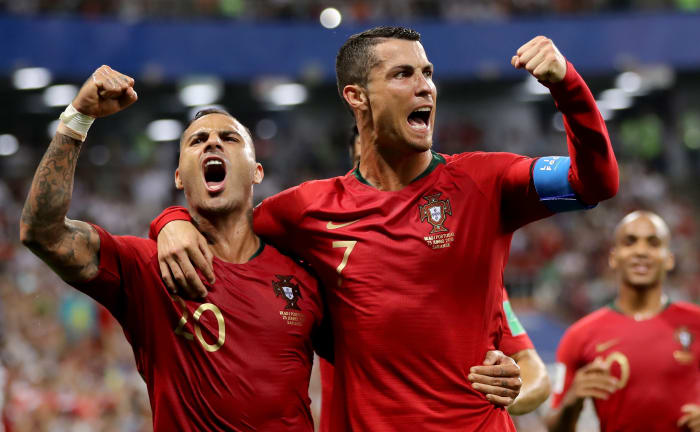 Portugal team celebrating as the qualified for  knockout stages