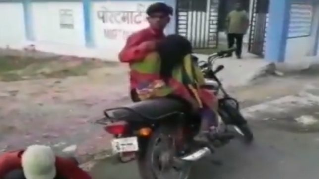the man carying dead body of mother on bike