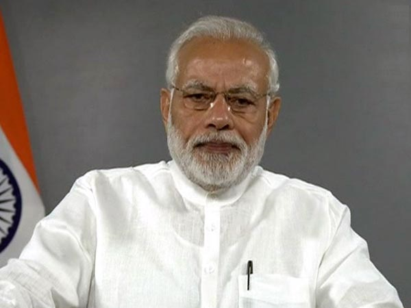 Narendra Modi interacts with Gram Jyoti Yojana beneficiaries