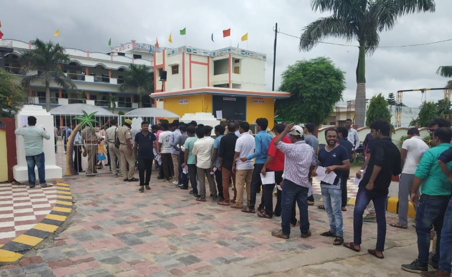 People Standing to enter the examination center