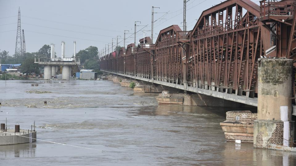 A view of the swollen Yamuna River near Old Iron Bridge in New Delhi on July 29