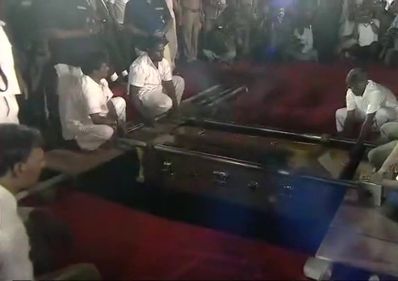 M Karunanidhi being laid to rest near Anna mausoleum