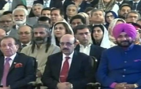 Navjot Singh Sidhu sitting next to President of Pakistan occupied Kashmir Masood Khan