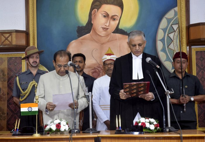 Assam governor Jagdish Mukhi administering the oath  to Justice Bopanna, as new chief justice of Gauhati High court, at Raj Bhavan, Guwahati