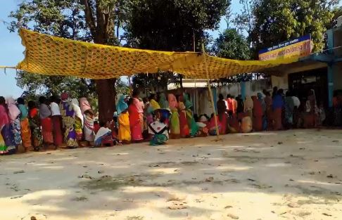 Voter stand in queue for casting their vote