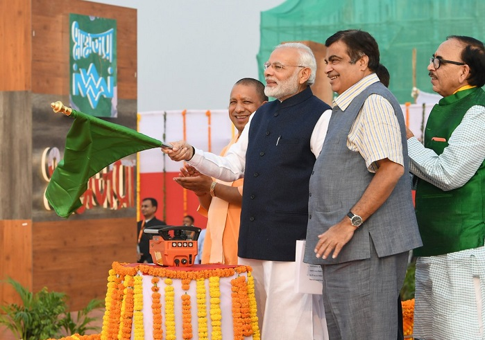 Prime Minister Narendra Modi with Union Minister Nitin Gadkari and UP CM Yogi Adityanath