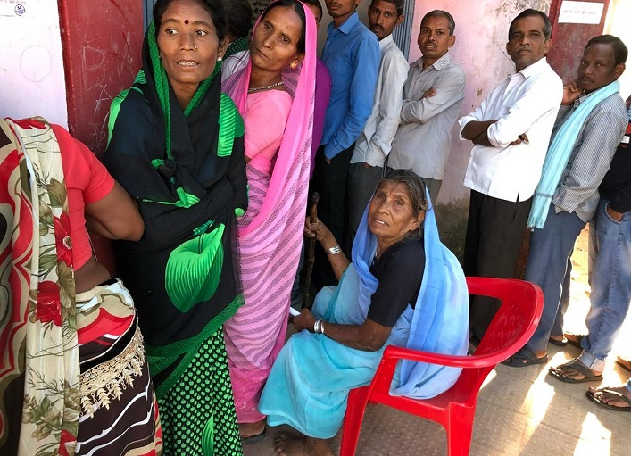 People standing in queue for casting their votes