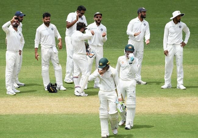 Indian team rejoicing over a wicket taken