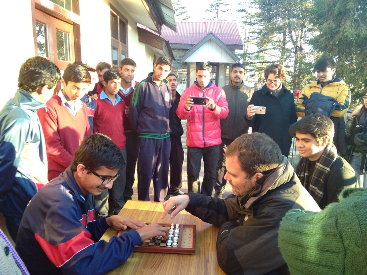 Rahul Gandhi engaged in a game of chess with specially-abled child