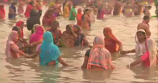 Devotees taking a holy dip at Ganga Sagar on the occasion of MakarSankranti in Prayagraj on Monday.