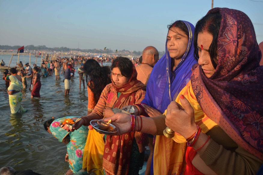 Hindu devotees offer prayers after taking holy dip at Sangam, the confluence of River Ganga, Yamuna and mythological Saraswati, on the occasion of Maghi Purnima