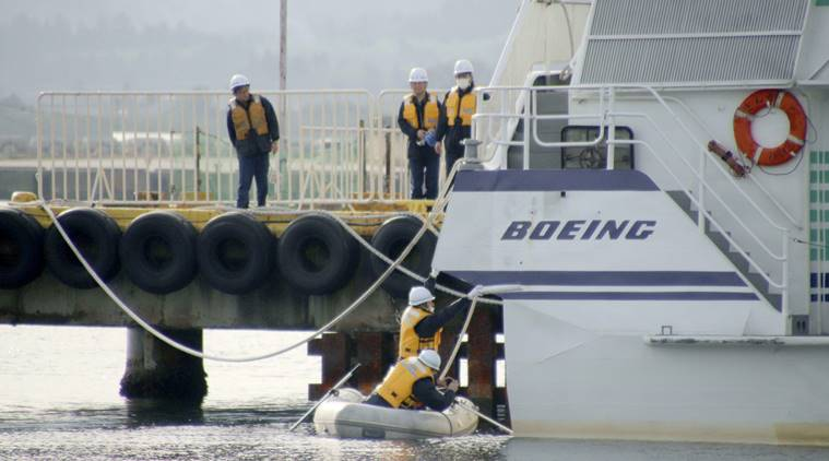 Coast guard crew investigate the damage of a ferry which collided at a port in Sado city, Niigata prefecture