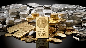 Gold, silver prices drop on low demand