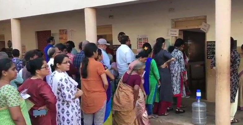 Voters line up outside polling booths