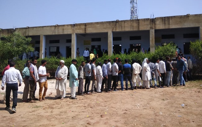 People standing in queue in Mathura