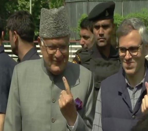 National Conference leaders Farooq and Omar Abdullah posed for a photo after casting their votes